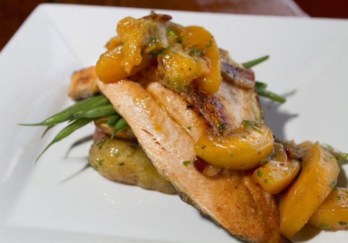 Ruby red trout over roasted fingerling potatoes with peach compote.