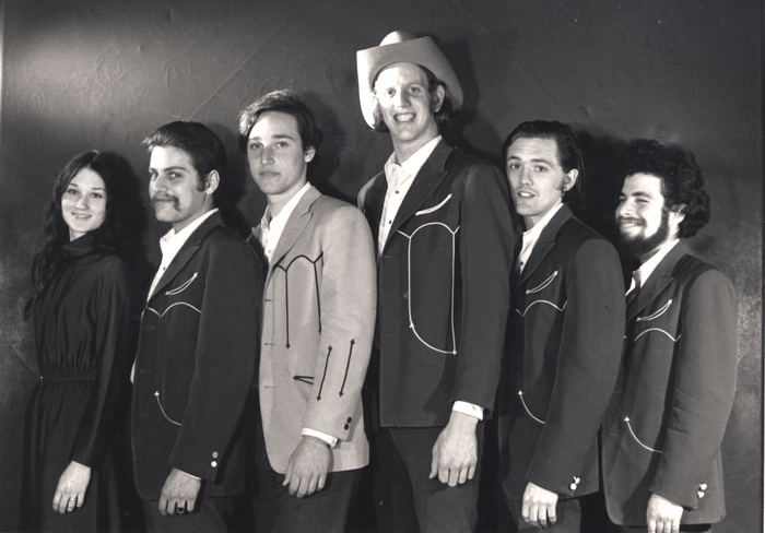 An early 1970s photo of the band (Chris O'Connell, Gene Dobkin, Floyd Domino, Ray Benson, LeRoy Preston, Lucky Oceans)