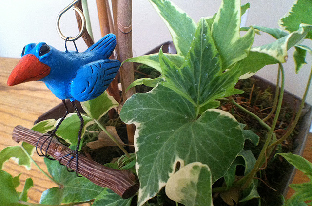 This carefree blue bird could live on an indoor plant.