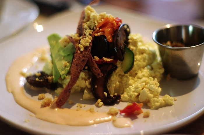 breakfast scramble, marinated veggies, blue corn strips, parmesan, red jalapeno cream and smoked tomatillo salsa. PHOTOGRAPHED BY KARPOV WRECKED TRAIN
