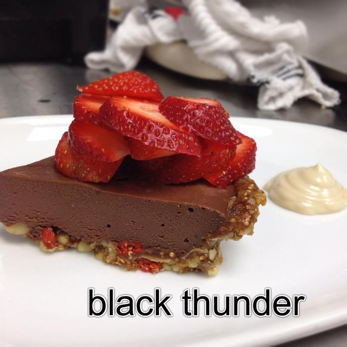 black pepper chocolate tart, goji-fig crust, strawberries, pink salt, ginger cream