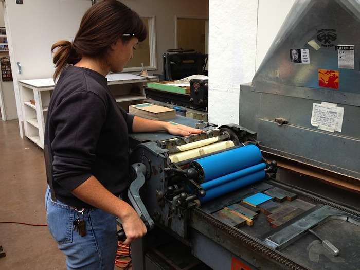 Here I am in my studio printing promotional cards for the project on a Vandercook press