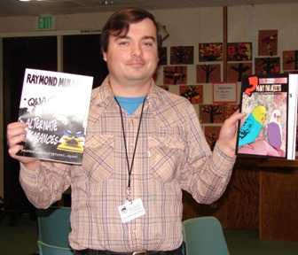 Here is a picture of me holding up other books that I made.