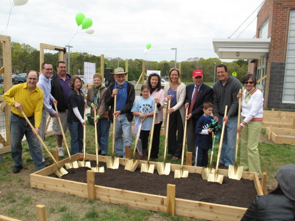 Legislators, community members, and staff celebrate the community garden at Hampton Bays Middle School, which was initially funded through a Cornell Cooperative grant.