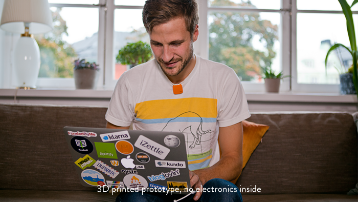 One of the co-founders, Oskar Kalmaru, wearing the Memoto Orange prototype