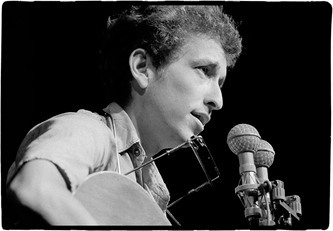 Dylan solo at Newport 1963. Yours with your pledge.