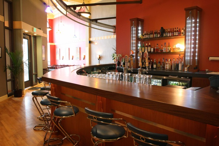 The sweeping Art Deco-styled bar is the centerpiece of The Kress as you enter. The Art Deco theme carries throughout the varied and unique restaurant and lounge areas.