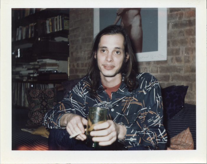 John Waters at Danny Fields NYC pad below Iggy Pop's man-parts '73