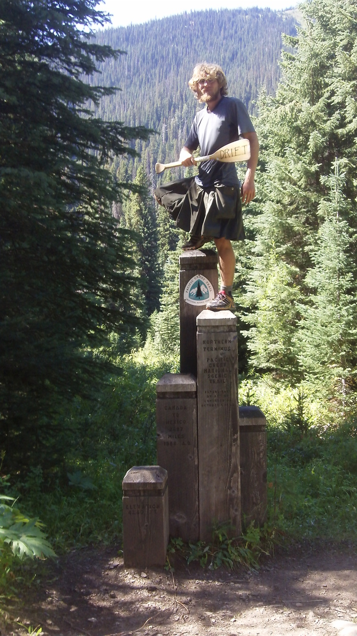 Crossing the Canadian border after hiking 2700 miles on the Pacific Crest Trail
