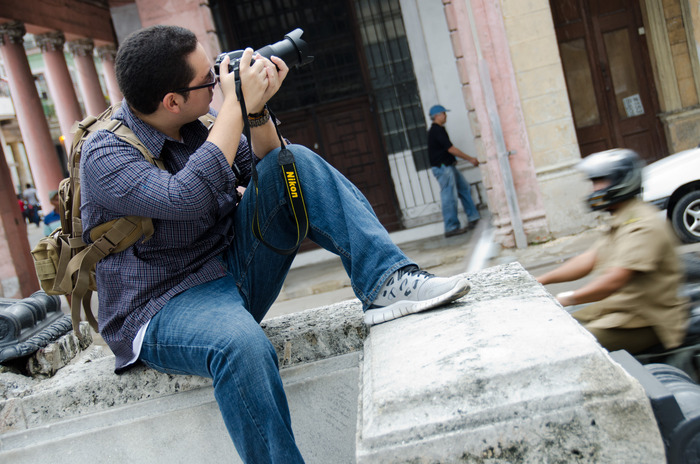Stony Brook journalism student Kevin Lizarazo at work in Cuba