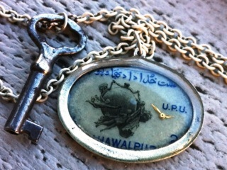 A Double-Stranded Necklace made from a vintage key and a vintage Bahawalpurian stamp (Reward level $65)