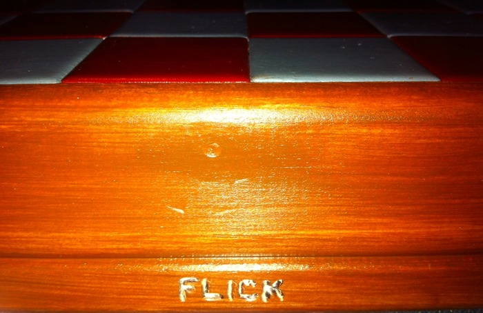 FLICK (engraved into ceramic board)