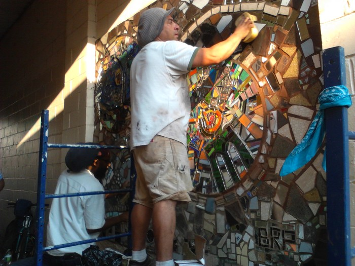 Carlos Pinto completing the mosaic from Phase 1 of the project