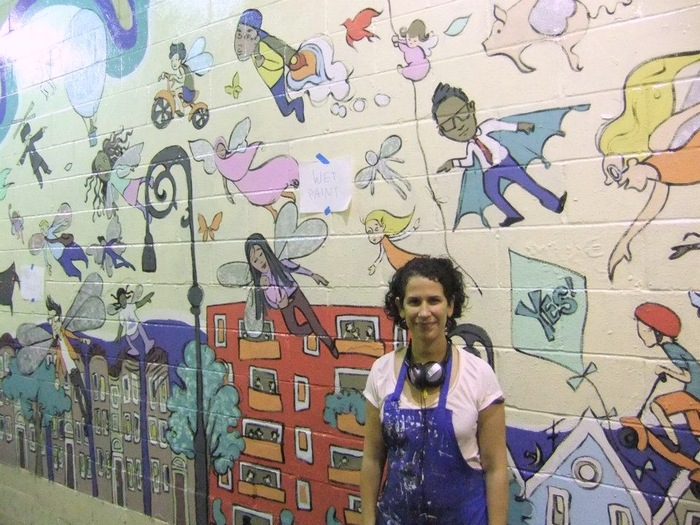 Susan Jaramillo and her mural from Phase 1 of the project
