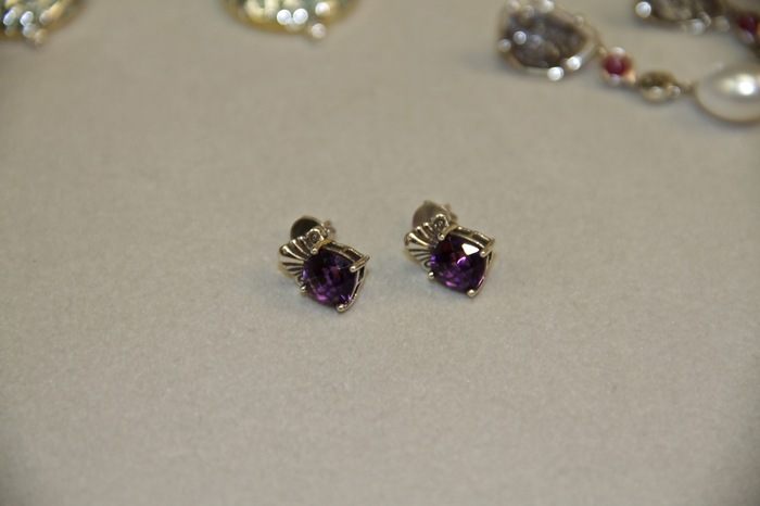 Sterling silver earrings with an amethyst stone.