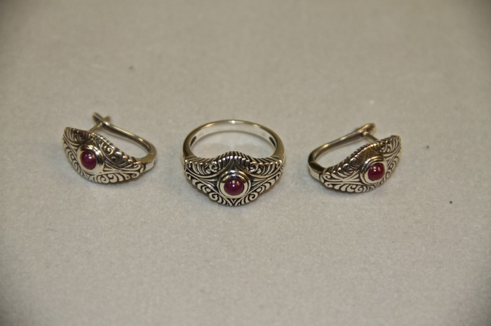 Beautiful earrings (pictured here with matching ring), designed from a doorknocker artifact from the Spanish ship San Lorenzo. The earrings are 925 sterling silver, and rhodium plated, with a genuine ruby.