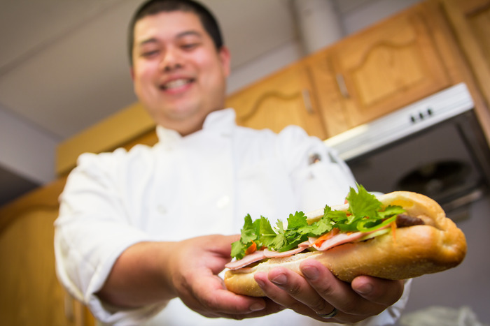 Chef Davis with a freshly made Banh Mi