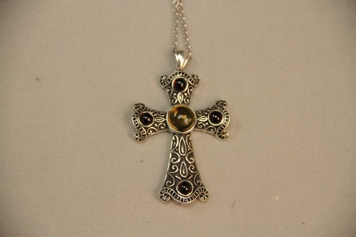 Our exquisite sterling silver cross with citrine and rubys cabochon precious stones.