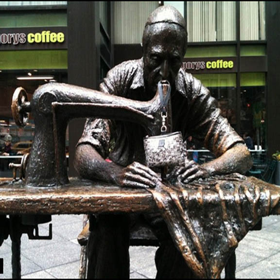 the Garment District tailor statue right in front of Gregory's Coffee