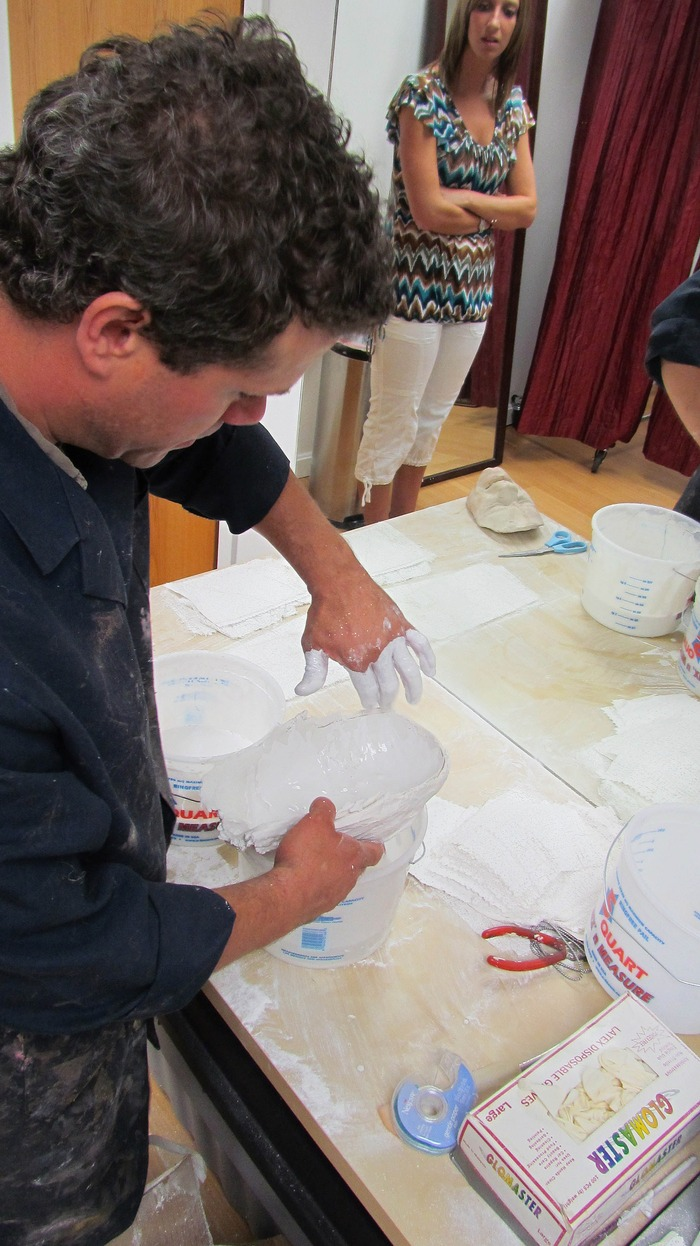 Jeff fills the negative/mold with plaster
