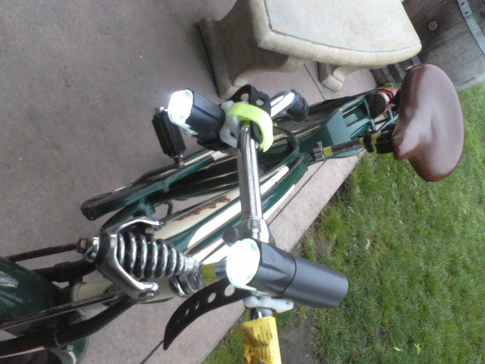 Two of my six working prototypes, demonstrating rotating handlebar mount, on my Dad's 1946 Schwinn.