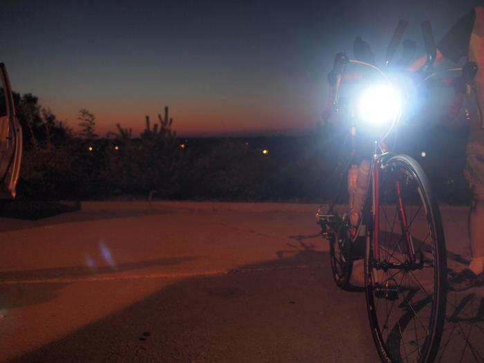 """I have a feeling we're not in Kansas anymore"", as Joan Deitchman's Race Across America bike is prepped after entering Missouri for another 12 hour overnight of nonstop riding, and nonstop lighting."