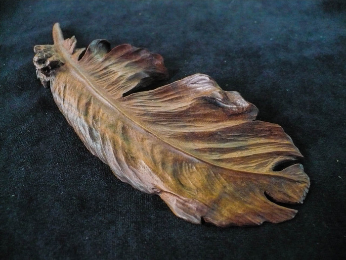 Walnut carved feather