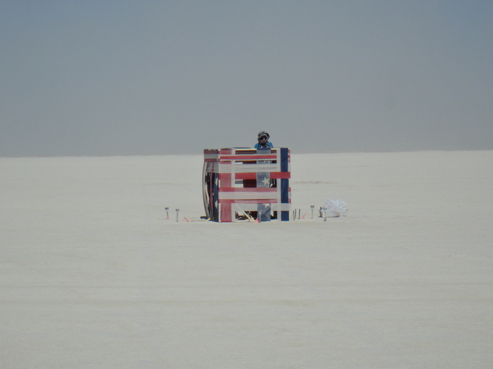 "Me working on ""American Cube"" on the playa in the Black Rock Desert, Nevada."