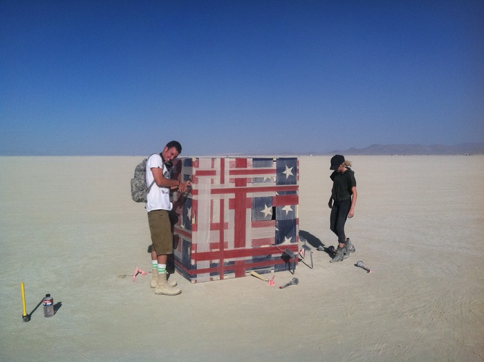 "My brother, Brandon and his girlfriend, Caitlin, with ""American Cube"" on the playa."