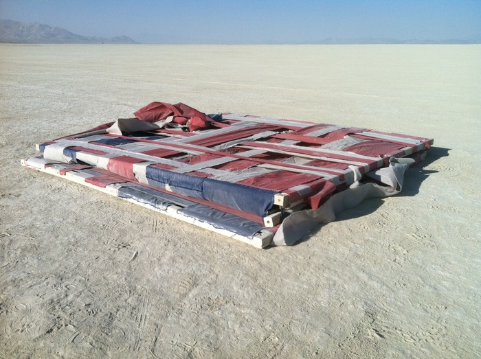 """American Cube"" collapsed and ready to find its new home in a desert container."