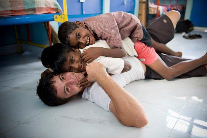 Rocky Braat, originally from Pittsburgh, with two kids from the orphanage in Chennai, India