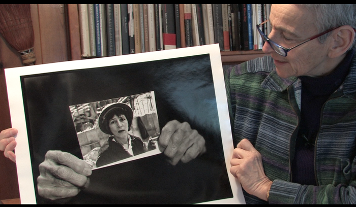 95 Lives still: Penny Wolin with her image of Levitt's hands holding vintage image of young Levitt ©2012 Penny Wolin ©2012 Tanya Sleiman / All Rights Reserved