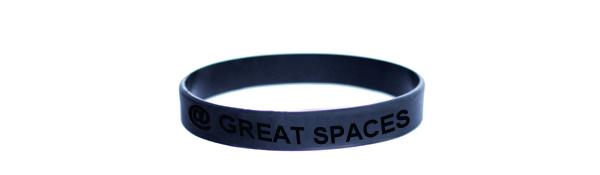 "Autumn/Winter 2012-13 release wristband. Blue ""@GREATSPACES"" debossed text. Made in USA. One size fits all."