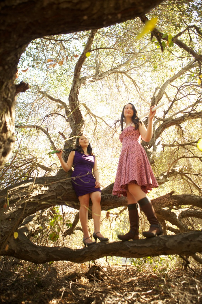Jennifer and Kara in a tree with swords. Not our safest idea.