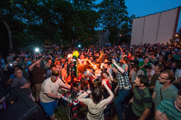 Dan Deacon performs on Barclay street at the May Final Friday: Open Walls Baltimore Finale. Photo by Theresa Keil.