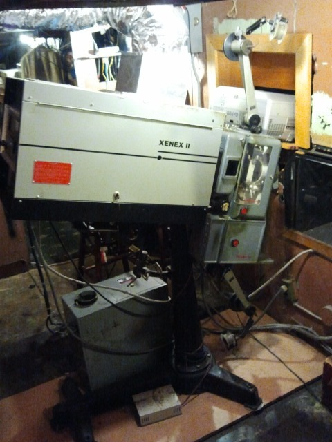 Our old 35mm projector, a beast from a bygone era!  We will keep her up and running for screening  35mm classics, but she will soon be getting a much deserved rest.