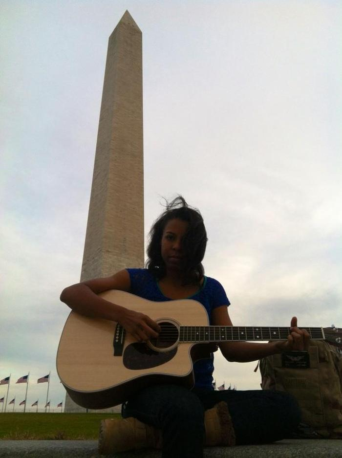 Nicole playing for a crowd in DC