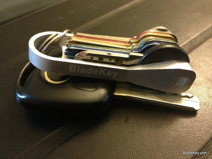 Silver Aluminium BladeKey N9 with 8 keys and attached to a modern car key.