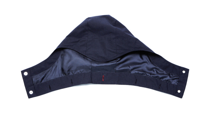 detachable hood with interior pocket for hood storage