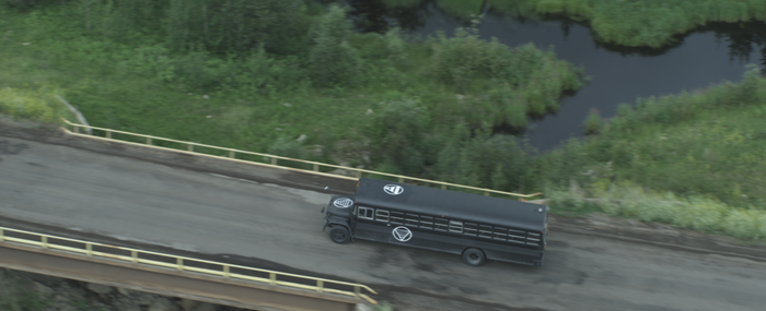 Helicopter aerial of the bus in motion.
