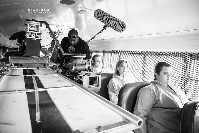 Pro camera operator Ryan Skeete works his magic along the dolly inside the bus.