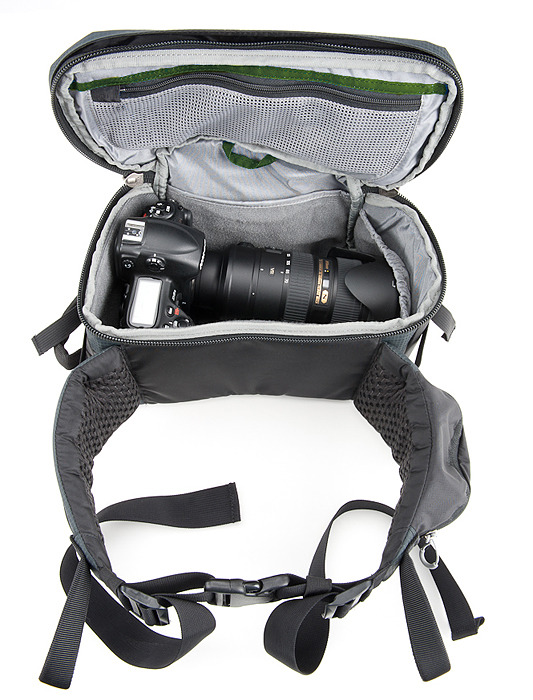 The integrated rotating belt pack can be removed and used alone. The padded waist belt has a small pocket on one side, and rail for our modular lens case on the other side.