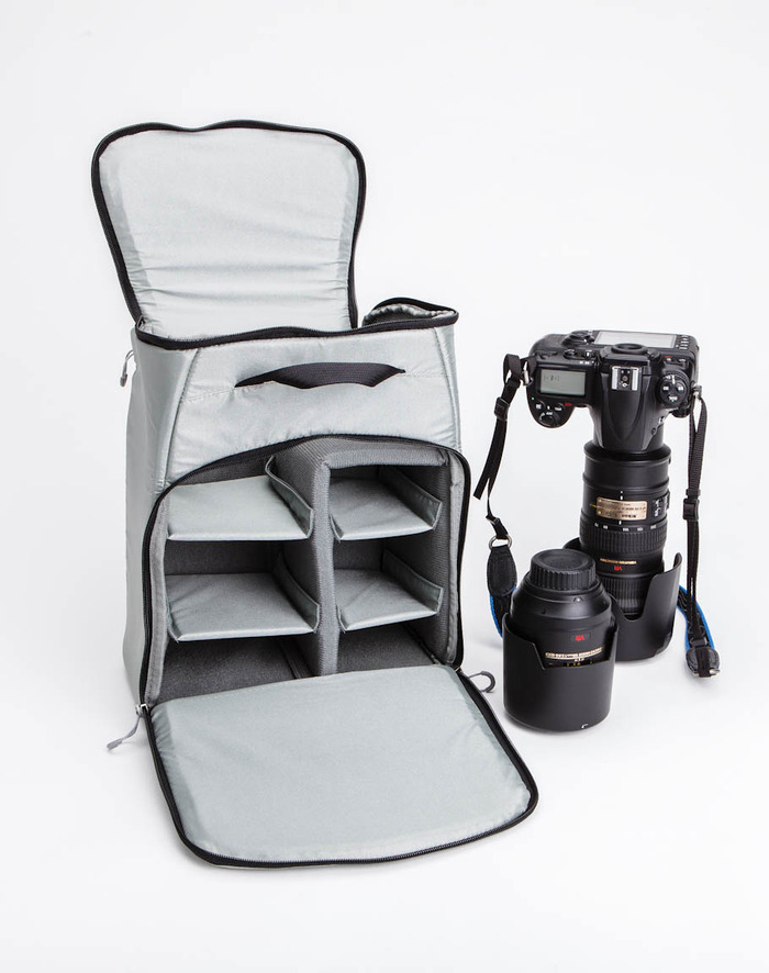 The padded camera gear insert holds photo gear up to a 70-200mm lens with body attached and several other lenses.