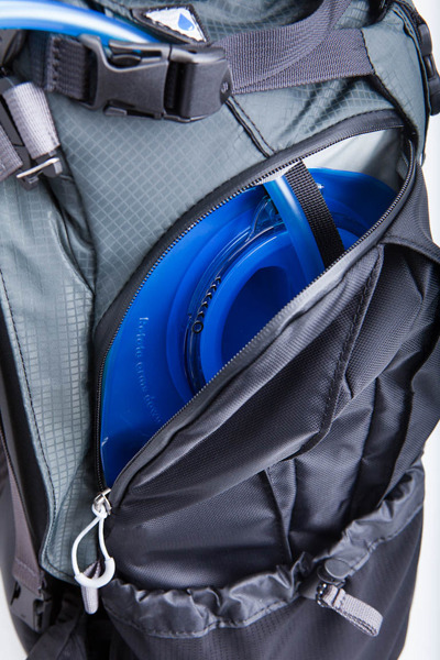 Side hydration pocket accepts bladders up to 3 liters and keeps water separate from other gear.