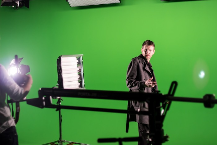 Filming an action scene with Wayne and the camera on a crane.