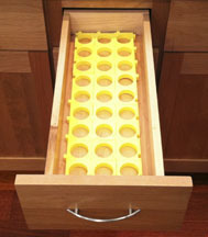 Yellow Kuzzles in a drawer ready to hold Keurig K-kups