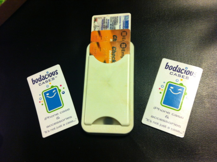 water-resistant iPhone case with credit card slot holding an I.D. and 2 credit cards