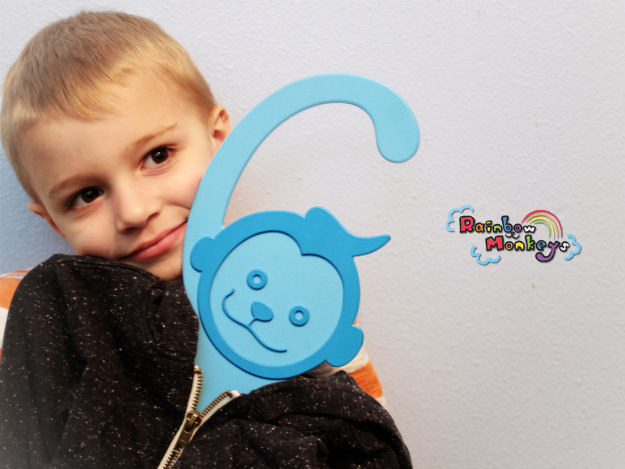 Our product tester, Bryce, with the blue Rainbow Monkey.
