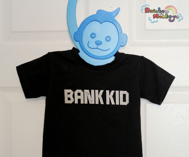 Close-up of the blue Rainbow Monkey wearing a shirt.