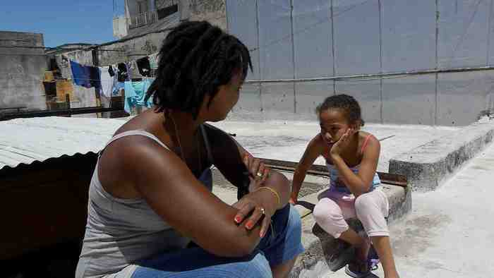Elizabeth Suarez and her niece talk on their rooftop in Montevideo
